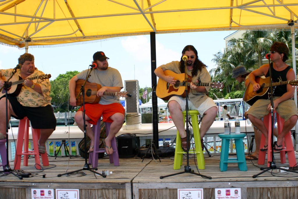 So the guy to the left of me is CHRIS STAPLETON. Yep On the ends are Brett James and Craig Wiseman.  Key West Songwriters Festival around 2005.